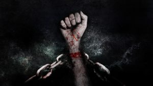 Hands breaking free of chains