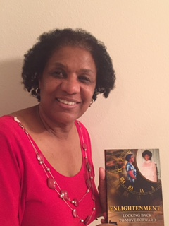 Picture of Debra holding her book up and smiling.